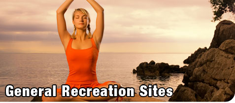 General Recreation. Beautiful Blonde Woman doing Yoga on a Cliff by the Ocean